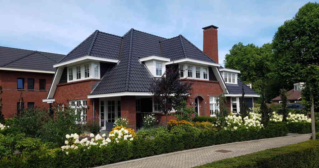 kosten Moderne luxe villa in jaren 30 stijl ontworpen door architectenbureau Hoogsteder architecten te Raalte
