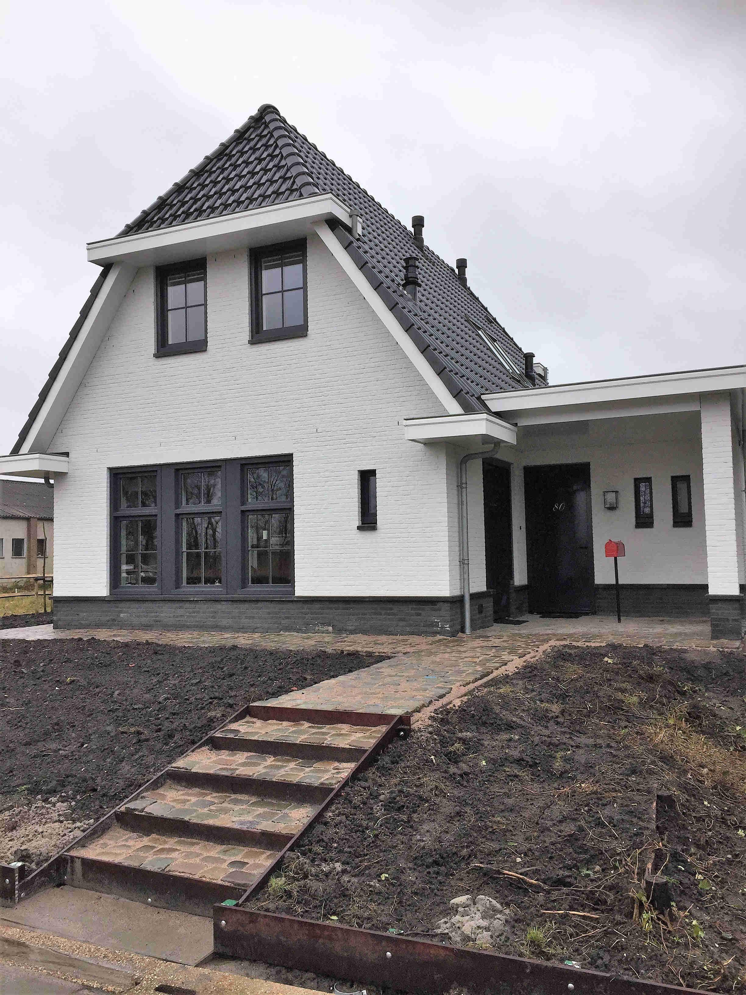 moderne nieuwbouw woning wit gestuct stucwerk baksteen vrijstaand luxe leimuiden architectenbureau hoogsteder architecten