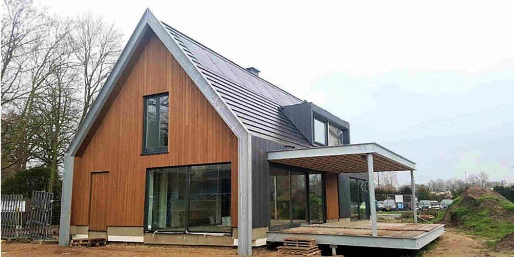 raalte tolhuis moderne woning schuurwoning staal hout overkapping licht glas hoogsteder architecten architectenbureau